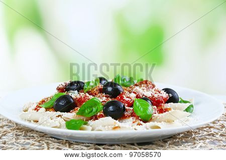 Pasta with tomato sauce on bright background