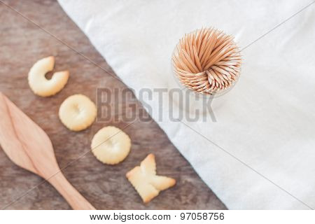 Cook Alphabet Biscuit With Fusili Pasta Alphabet Biscuit On Wooden Table