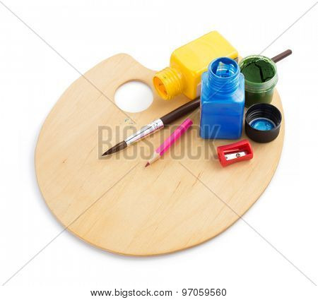 wooden palette and paint on white background