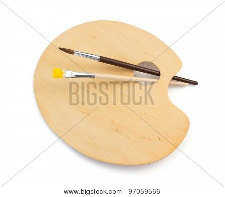 wooden palette and paintbrush isolated on white background