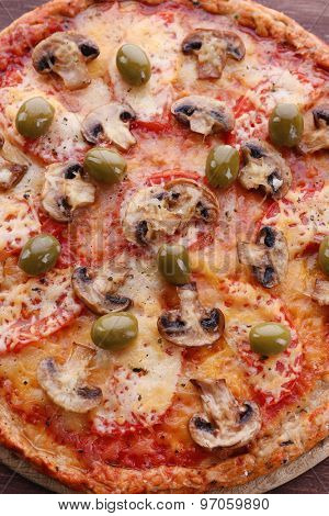 Tasty pizza with vegetables close up