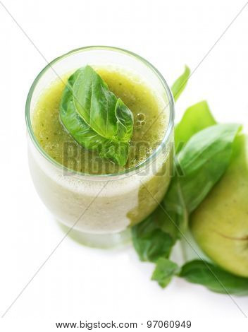 Glass of green healthy juice with basil and apple isolated on white