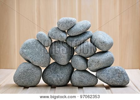 Sauna Stones. Stacked On A Wooden Surface. Ready For Heating.