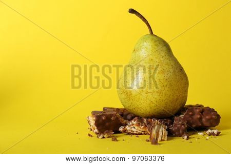 Concept of healthy and unhealthy food on color background