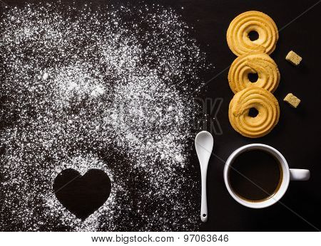 Minimalist Breakfast With Coffee, Biscuits, Brown Sugar Cubes, And Heart Shape Made In Flour