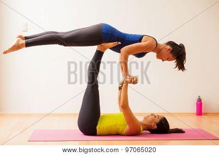 Acrobatic Yoga In A Gym