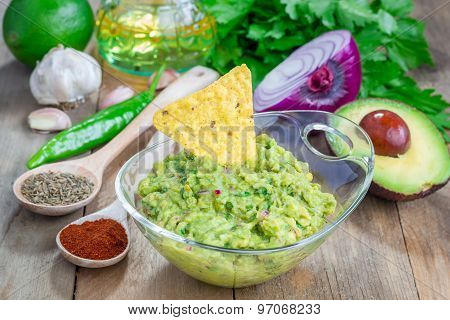 Bowl With Chunky Guacamole And Ingredients