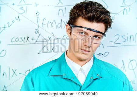 Close-up portrait of a young scientist in the laboratory. Research work. Doctor, hospital. Healthcare. Occupation.
