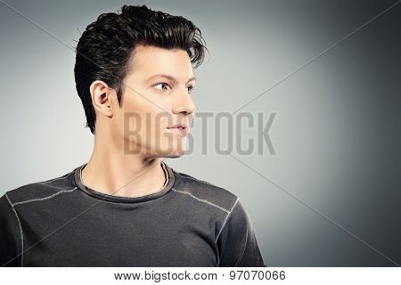 Close-up portrait of a serious hamdsome young man. Businessman. Men's beauty, fashion.