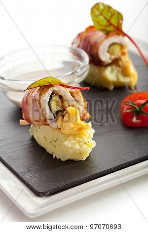 Bacon Wrapped Chicken Breast on Mashed Potato with Mushrooms Sauce