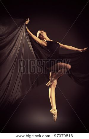 Graceful beautiful ballet dancer posing at studio. Art concept.