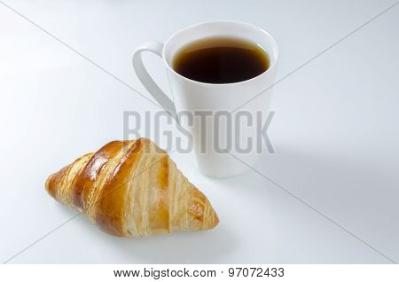 Breakfast Cup Of Coffee And Croissant.
