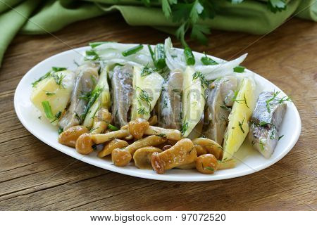 appetizer of herring, boiled potatoes, pickled mushrooms and onions