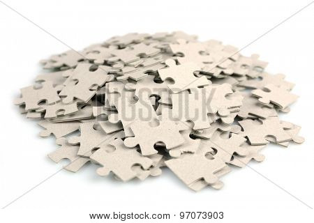 Pile of puzzle pieces isolated on white