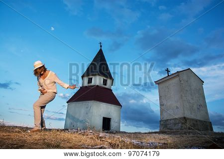 Young Woman Imitates Guitar Playing By The Church On The Hill
