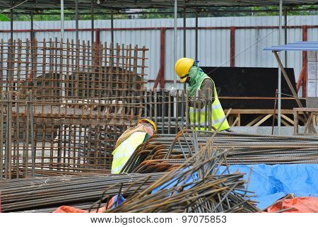 Construction workers working at Steel bar bending yard