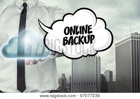 Online backup text on cloud computing theme with businessman