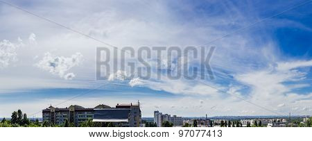 Sky With Cirrus Cloud Against The Backdrop Of The City