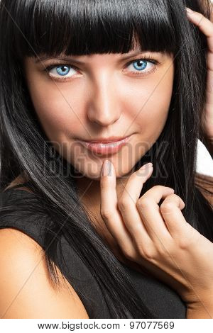 Portrait Of Beautiful Young Dark-haired Woman Close Up