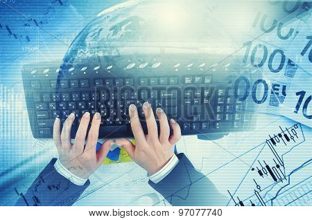 Hands of businessman running with fingers on black keyboard