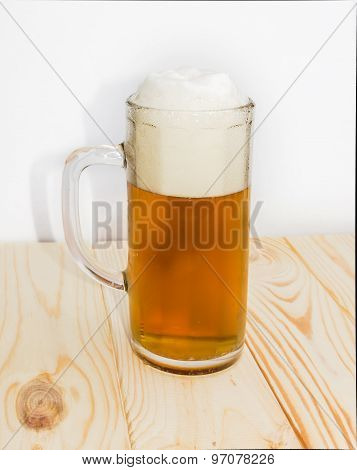 Mug Of Beer On Wooden Surface