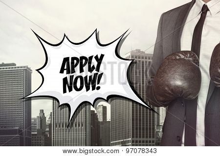 Apply now text with businessman wearing boxing gloves