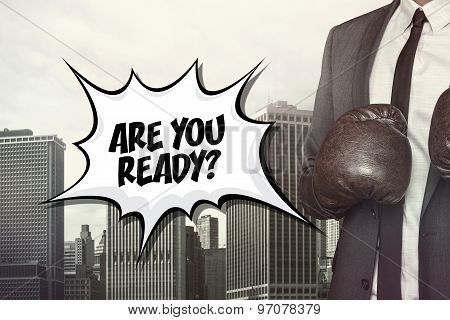 Are you ready text with businessman wearing boxing gloves