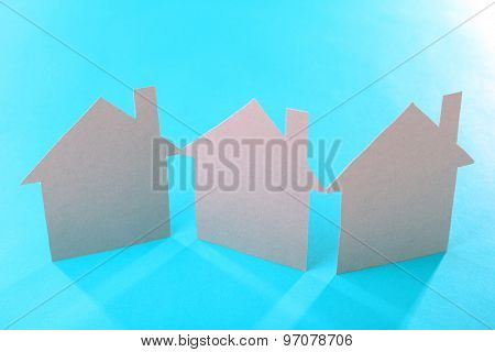 Color paper houses on turquoise background