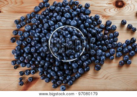 Fresh Organic Blueberries On Wooden Table. Background.