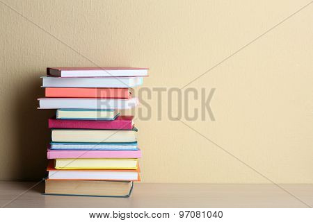 Stack of books on shelf.