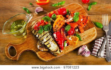 Grilled Vegetables On A Wooden Cutting Board.