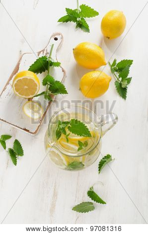 Water With Fresh Lemon And Mint Leaves In  Glass Jug.
