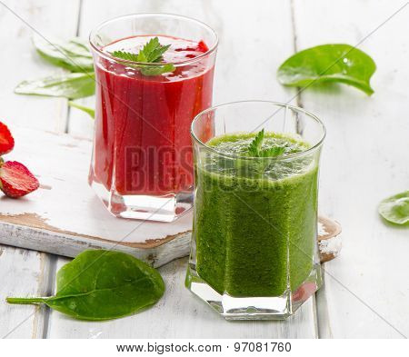 Healthy Spinach And Strawberry Smoothies On A Wooden Table.