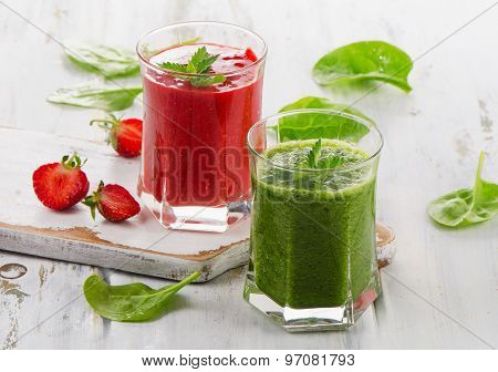 Healthy Fresh Spinach And Strawberry Smoothies On A White Wooden Table.