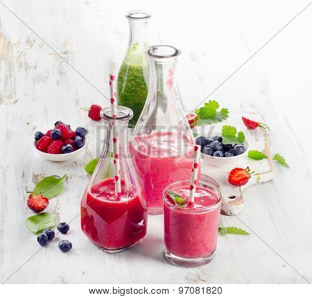 Healthy Fresh Smoothies With Berries On  A  Wooden Table.