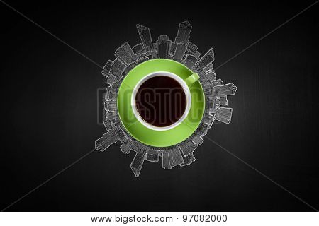 Top view of cup of coffee on black background