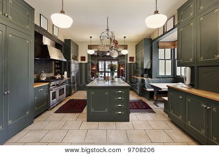 Large Kitchen With Green Cabinetry