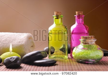 Bath Salts And Body Oil On Wood Brown Gradient Background
