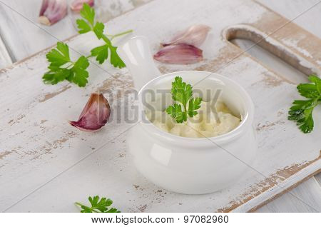Fresh Garlic Sauce On  White Wooden Table.