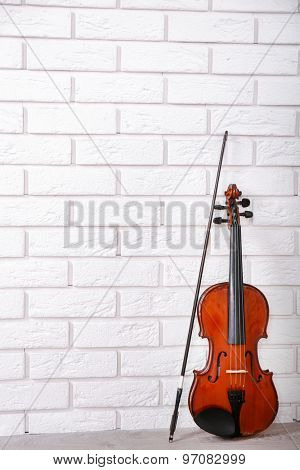 Violin on bricks wall background