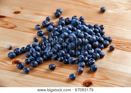 Fresh Organic Blueberries On Wooden Table. Background