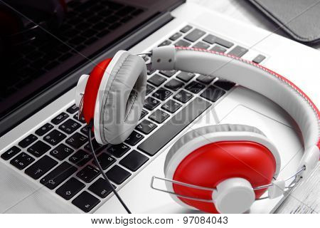 Headphones with laptop close up
