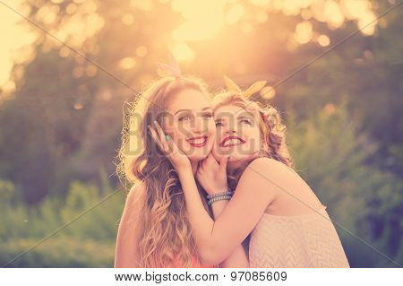 Happy Best Girlfriends Embrace. Sunset.