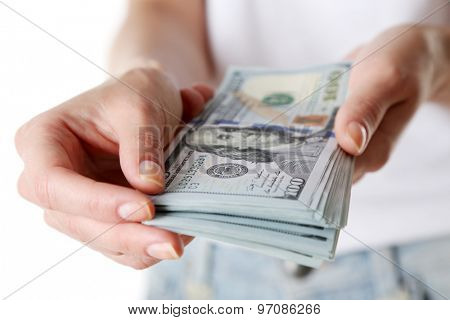 Female hands holding dollars, closeup
