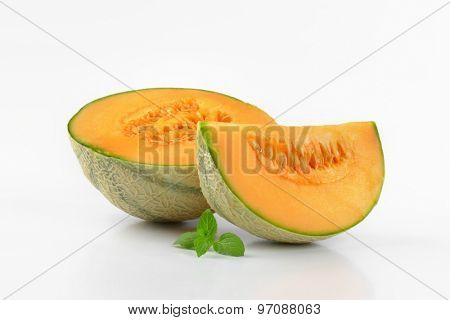 sliced cantaloupe melon on white background
