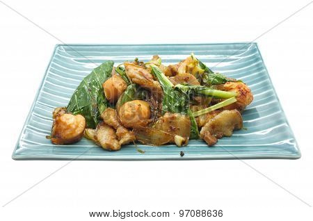 Stir fried green vegetables with pork and sausage