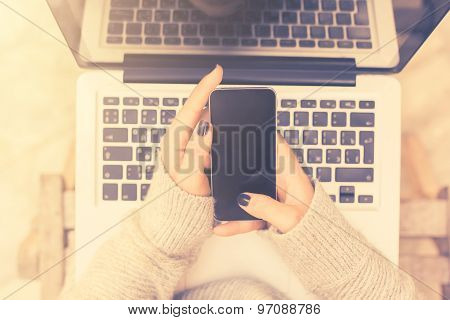 Girl With Cell Phone And Laptop