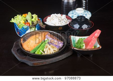 Japanese Cuisine. Hot Plate Fish On The Background