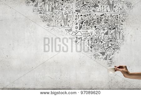 Coffee cup and business strategy sketches on background