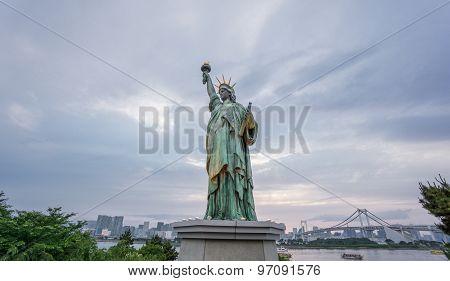 Statue of Liberty and Rainbow bridge in Odaiba at sunset